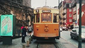 A beautiful ancient yellow Portuguese tram arrived at the terminal station. the tram driver asked to get the passengers out of the. Car stock footage