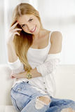 Beautiful And Attractive Blonde Woman Posing In Blue Jeans Dress Royalty Free Stock Image