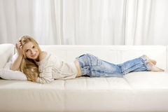 Beautiful And Attractive Blonde Woman Posing In Blue Jeans Dress Royalty Free Stock Photos