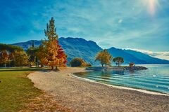 Free Beautiful And Colorful Autumn In Riva Del Garda,Garda Lake,The Anchored Boat In Riva Del Garda , Lago Di Garda, Italy Stock Photos - 187562083