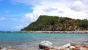 Beautiful Andaman Sea and Blue Sky. landscape on. The island with houses and trees on the mountain waves beating against the rocks. Video 1920*1080 stock video footage