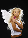 Beautiful angel. Holding a heart Stock Photography