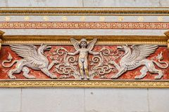 Beautiful angel as defender with mystical dragons at the roof top of main facade of Parliament in Vienna, Austria. Details, closeup stock image
