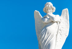 Beautiful angel on a blue sky background Royalty Free Stock Images