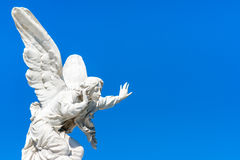 Beautiful angel on a clear blue sky. Beautiful angel with a clear blue sky background with space for text stock photography