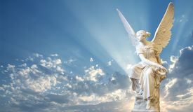 Beautiful angel in heaven. With divine rays of light Royalty Free Stock Photos