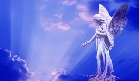 Beautiful angel in heaven. With divine rays of light stock photo