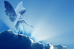 Beautiful angel in heaven. With divine rays of light Stock Photos