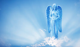 Beautiful angel in heaven with divine rays of sun light Royalty Free Stock Image