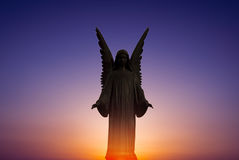 Beautiful angel in heaven over bright sunset Stock Images