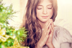Beautiful angel praying Stock Images