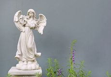 Beautiful angel statue against gray wall background.  royalty free stock photo