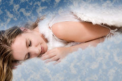 Beautiful angel surrounded by clouds Royalty Free Stock Image