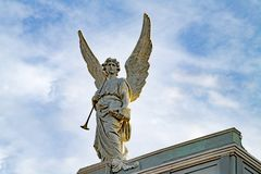 Beautiful angel with tall wings, Santiago de Cuba. Beautiful angel with brass instrument on roof of Cathedral Basilica of Our Lady of the Assumption, Santiago de royalty free stock photography