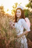 Angel woman in a grass field with sunlight. Beautiful angel woman in a grass field with sunlight Stock Images
