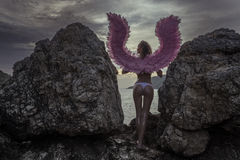 Beautiful angel woman with pink wings Stock Image