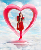 Beautiful angel woman sending love from the sky Royalty Free Stock Image