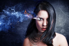 Beautiful anger, girl with burning eye Stock Photos