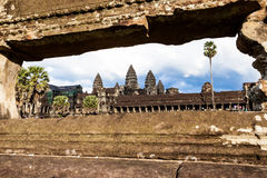 Angkor Wat through the frame. Beautiful Angkor Wat in frame made by the hole of the wall,Siem reap, Cambodia royalty free stock photography