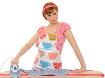 Beautiful angry house woman ironing Stock Photo
