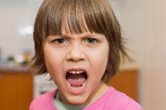 Beautiful Angry Little Young Girl.  Royalty Free Stock Photos