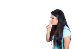 A beautiful angry woman placing finger on lips Royalty Free Stock Images