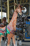 Beautiful animals on carousel ride, Baltimore Zoo, Maryland,2015. Gorgeous craftsmanship in each wild animal depicted in working carousel, Baltimore Zoo stock photo