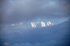 Beautiful Annapurna range seen through the clouds Stock Photos