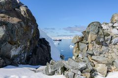 Beautiful Antarctiс seascape with expedition vessel and iceberg. Beautiful Antarctiс seascape with iceberg at sea with calm weather stock photography