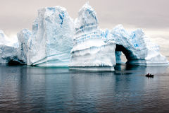 Beautiful antarctic icebergs with zodiac in front Stock Image