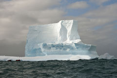 Beautiful antarctic icebergs with zodiac in front Royalty Free Stock Images