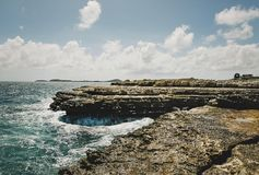 Beautiful Antigua in the Caribbean. Rocky shore near St. John`s in Antigua in the Caribbean Sea Royalty Free Stock Photo