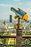 Beautiful antique binoculars watching over champs de mars towards tour Montparnasse. royalty free stock photos