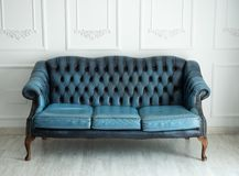 Beautiful antique blue sofa on a light background Stock Images