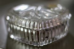 A beautiful antique crystal heart shaped  jewelry box with bokeh effects royalty free stock images