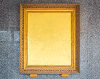Beautiful antique gold frame on the wall . Royalty Free Stock Images