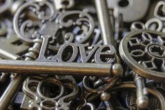 Beautiful Antique Keys with the word Love Close Up.  Stock Photos