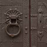 Antique metal strong door with handle. Beautiful antique metal door with a handle and a lock, very strong and reliable royalty free stock images