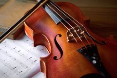 Beautiful Antique Violin and Book. On Table Stock Photography