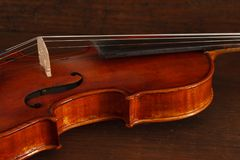 Beautiful antique violin on brown wood background royalty free stock photos