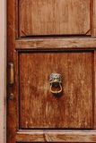 Beautiful antique wooden doors in Italy with metal handles royalty free stock image