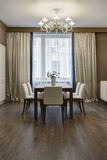 Beautiful apartment, interior room. With table and five chairs Royalty Free Stock Photos