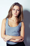 Beautiful apathetic woman with crossed arms. Studio shot Royalty Free Stock Images