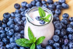Beautiful appetizer blueberry fruit smoothie milk shake glass jar with juicy fresh berries background top view Yogurt cocktail Nat. Beautiful appetizer blueberry Stock Photography