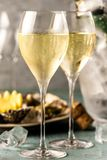 Beautiful appetizer oysters and glasses champagne on Festive Table royalty free stock photo