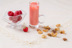 Beautiful appetizer pink raspberries fruit smoothie or milk shake in glass jar with berries background, top view. Yogurt cocktail royalty free stock photo