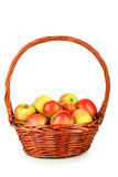 Beautiful apples in basket isolated on white Royalty Free Stock Photography