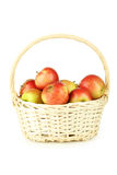 Beautiful apples in basket isolated on white. Stock Photos