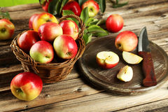 Beautiful apples on brown wooden background Stock Photo