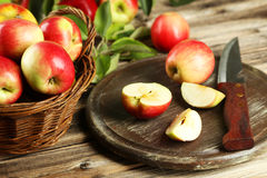 Beautiful apples on brown wooden background Stock Images